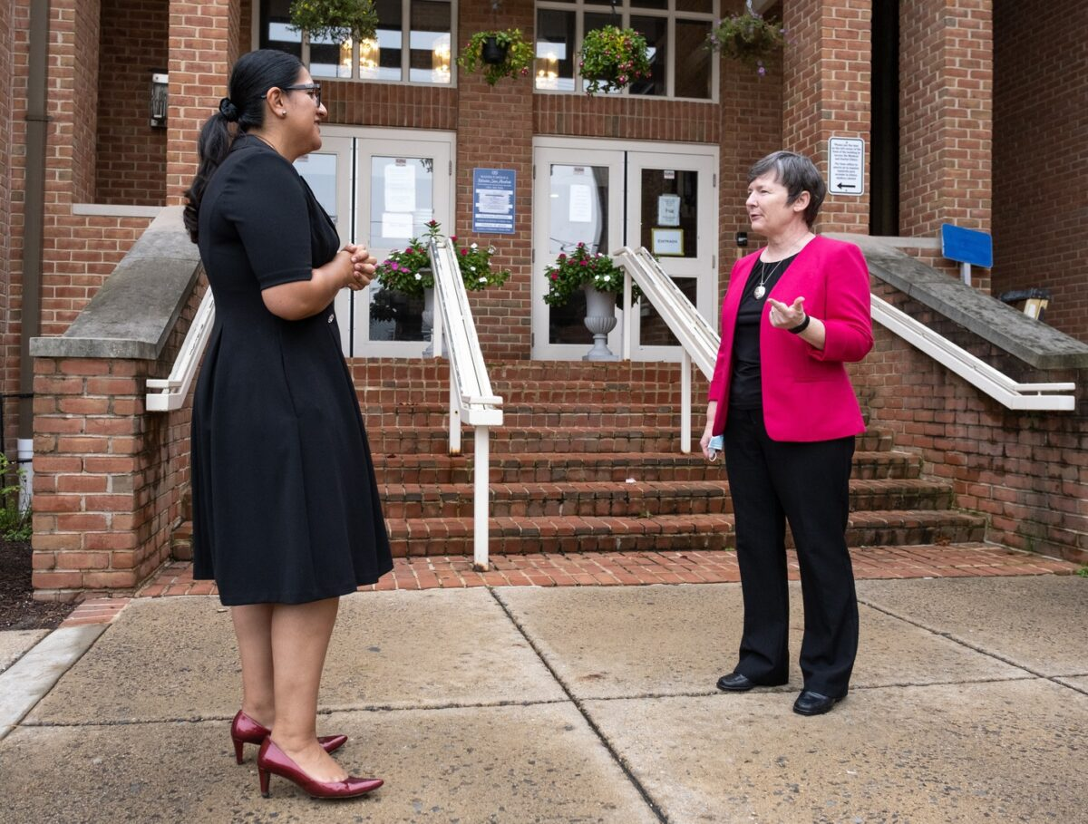 Sister Sharlet Wagner, at right, the executive director of Catholic Charities' Newcomer Network, speaks with Jenny Cachaya, navigators manager for the program. (Catholic Charities photo)